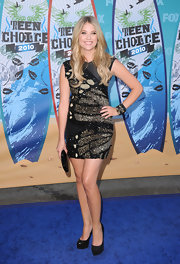 Ashley sported a sparkling mini dress with long flowing waves.