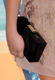 Ashley Greene paired her nude dress with a black box clutch.