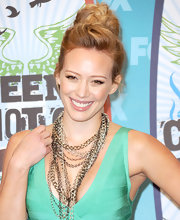 Hilary Duff highlighted her chain necklaces by wearing her long curls in a loose bun.