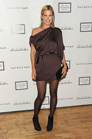 Mary toned down her super short mini dress with sheer black tights and a pair of black cage ankle boots.