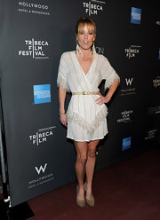 Actress Emma Caulfield showed off her bohemian-chic style at the Tribeca Film Fest in a fringe embellished white frock. She topped off her look with a pair of studded suede pumps.
