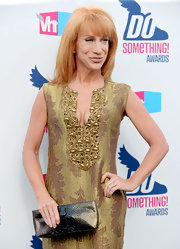 Kathy Griffin paired her gold embroidered dress with a patent leather clutch.