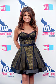 Paula wore her signature layered look with a bare neckline.