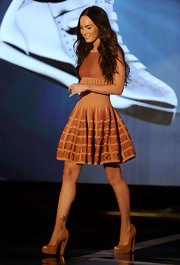 Megan donned an adorable Alaia cocktail dress with tan, platform, peep toe pumps. We loved this look from head to toe.