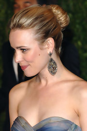 The stunning actress opted for a classic twisted bun to show off her stone-embellished dangling earrings. She left her look slightly messy for added textured and her highlights added dimension.
