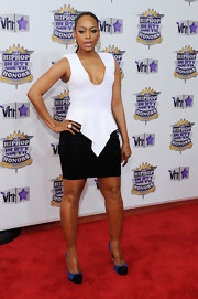 Trina paired her mini skirt with a plunging white blouse.