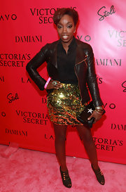 Estelle gave her glittering party look a military vibe with Christina Louboutin Loubout Ankle boots in olive.
