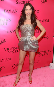 Adriana Lima put her best foot, and a lot of leg, forward in darling red satin peep-toes.