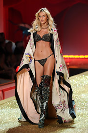 Anja Rubik looked fiercely sexy in studded underwear at the Victoria's Secret fashion show.