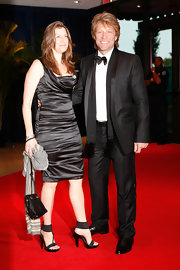 Dorothea Hurley dressed up in black satin cocktail gown. A heavy amount of ruching enhanced and flattered her curves.