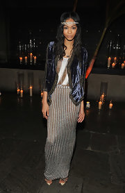 Chanel completed her bohemian-inspired ensemble with long center part curls complete with a sparkling headband.