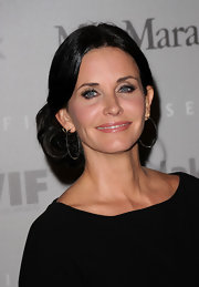 Courtney Cox showed off an elegant chignon and simple hoop earrings.