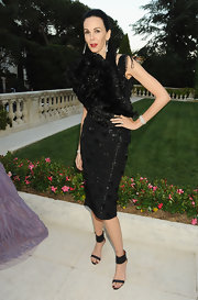 This out-there cocktail dress couldn't be pulled off by just anyone. L'Wren Scott wore this polka-dot and feathered number with confidence.