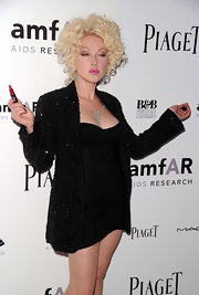 The flamboyant Miss Lauper modeled her self-named lipstick by MAC cosmetics and a platinum curly-cue hairdo.
