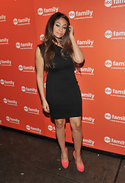Raven-Symone accented her asymmetrical LBD with coral suede platforms.