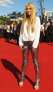 Havana Brown tucked a loose silk top with a plunging neckline inside her silver skinny pants for the 2011 ARIA Awards.