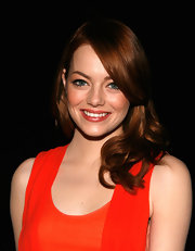 Emma Stone wore her long red locks in a pretty side-swept 'do for the 2011 American Museum of Natural History Gala.