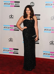 Hillary Scott of Lady Antebellum sparkled at the AMAs in a strapless sequined gown. A cinched waist and silver accessories were all the country starlet needed to complete her evening style.