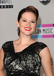 Sarah Drew attended the 2011 American Music Awards wearing a pair of black and white diamond drop earrings from the Open Hearts by Jane Seymour collection.