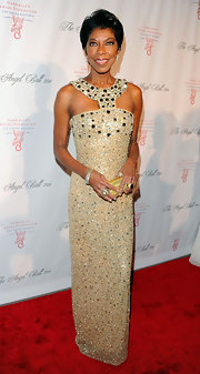 Natalie Cole paired her ultra-glam look with am petite gold hard case clutch at the 2011 Angel Ball.