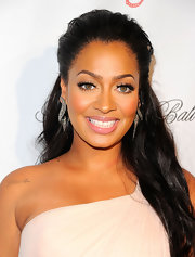 La La Anthony chose a subtle pink lip color for her beauty look.