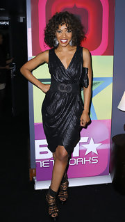 Wendy Raquel Robinson showed off her fit figure in a shimmery wrap LBD.