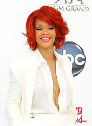 Rihanna switched her look up again at the Billboard Music Awards with a layered bob and side swept bangs.