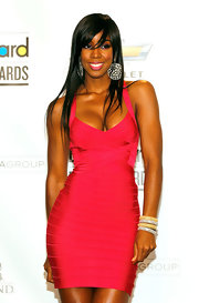 Kelly Rowland paired her sleek bandage dress with large silver spheres.
