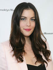 Liv Tyler amped up her natural makeup with a bold berry pout.