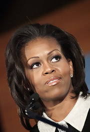 Michelle Obama wore a teased layered 'do at the 2011 Building a Healthier Future Summit.