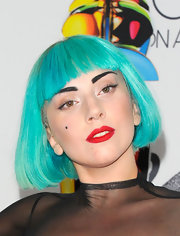 Lady Gaga isn't one afraid to take risks. She paired her teal bob with bright red lipstick.