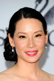 Lucy Liu added a bright pop of color to her look with bubble gum pink lipstick.