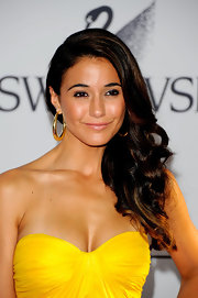 Actress Emmanuelle Chriqui attended the 2011 CFDA Fashion Awards wearing 18-karat gold Glamazon large chunky hoop earrings which worked wonders with her strapless canary dress.