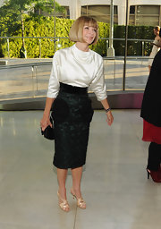 Anna Wintour complemented her demure CFDA ensemble with champagne patent sandals.