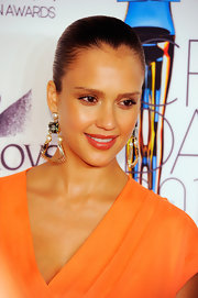 Jessica Alba was glowing on the purple carpet at the 2011 CFDA Awards. She accentuated her slick bun with decorative earrings complete with pearls and gemstones.