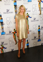 Naomi Watts teamed her loose gold sheath with nude platform peep-toes at the 2011 CFDA Fashion Awards.