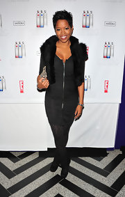 Malinda Williams paired her look with black suede cuffed boots.