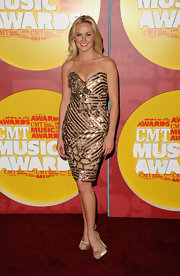 Laura Bell Bundy was one of the most stunning at the CMT Music Awards in a gold strapless cocktail dress and matching peep-toe pumps. The glowing songstress looked sun-kissed and wore her blonde locks down in soft unfussy waves.