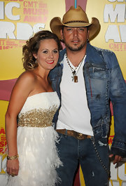 Jason's wife, Jessica Aldean, accessorized with a gold cuff which accented the gold embellishments on her cocktail dress.