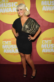Meghan Linsey of Steel Magnolia always has fun with fashion on the red carpet. Meghan donned a modernized '80s style with a black and gold cocktail dress. Meghan added a touch of sweet southern style to her look with flower in her side-swept hair.