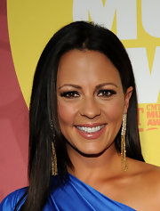 Sara Evans' dangling diamond earrings stole the show on the red carpet of the CMT Awards.