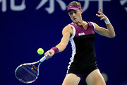 Samantha Stosur wore a purple sun visor while playing in the China Open.