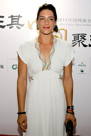Andrea Petkovic wore a white knit maxi dress with multicolored braided accents at the 2011 China Open.