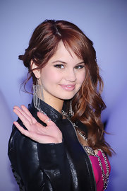 'Suite Life on Deck' actress Debby Ryan, waved to the cameras at the 2011 Disney Kids & Family Upfront presentation. She pinned her long curls to one side in a textured twists.