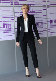 Robin Wright Penn looked effortlessly chic in a streamlined black suit with cropped trousers.