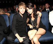 Selena Gomez was canoodling with Justin Bieber at the ESPY Awards wearing a black corset romper. SHe accessorized with gold jewelery and a half-up 'do.