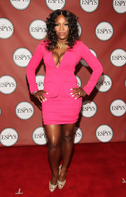 Serena Williams flaunted her assets at the 2011 ESPYs in a long-sleeved hot pink dress with a plunging V neck and major decolleté.