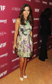 Marisol paired her pretty floral frock with a brown clutch. She finished off the look with tousled curls.