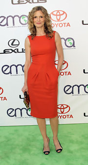 Kyra Sedgwick donned a chic orange sheath dress paired with slingback pumps.