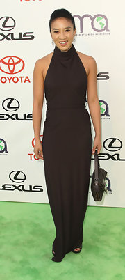 Michelle Kwan accessorized her simple draped halter gown with a brown printed bag.